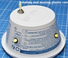 Rotating and moving plastic container