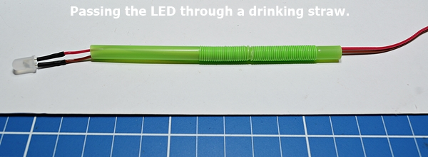 Passing the LED through the drinking straw