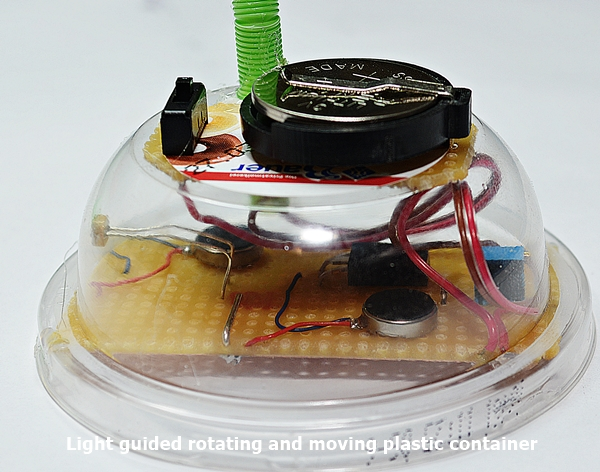 Light guided rotating and moving plastic container